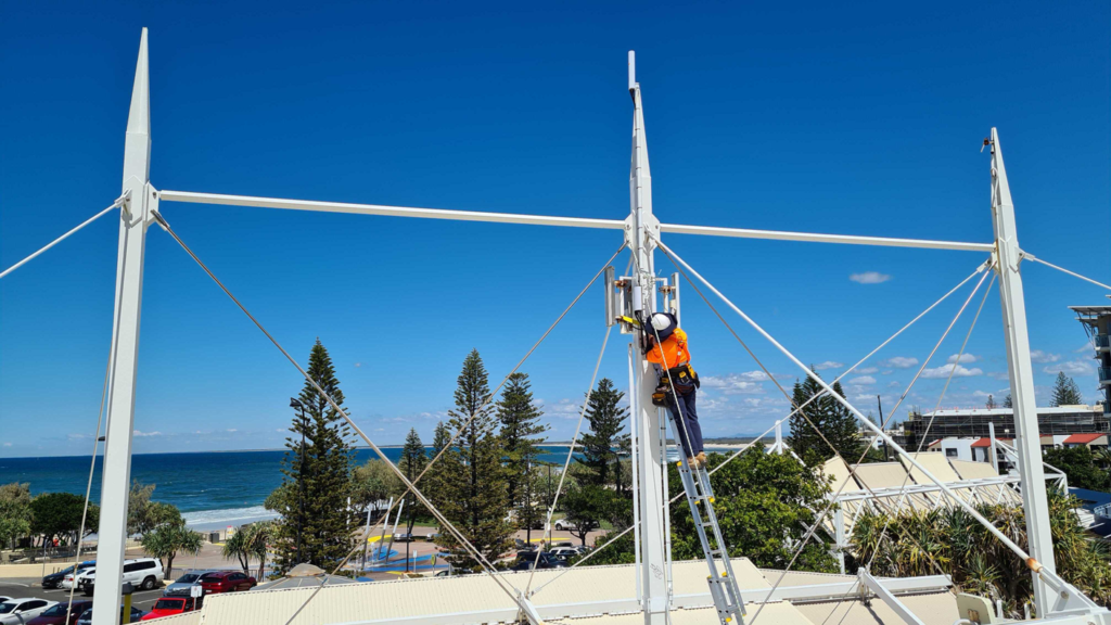 VostroNet deploying a Mimosa A5c MicroPoP for connectivity throughout the King's Beach precinct.
